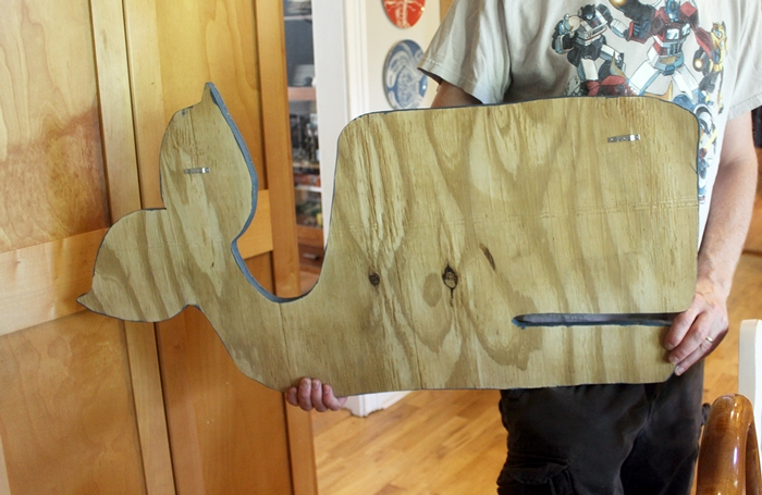 hangers on back of whale